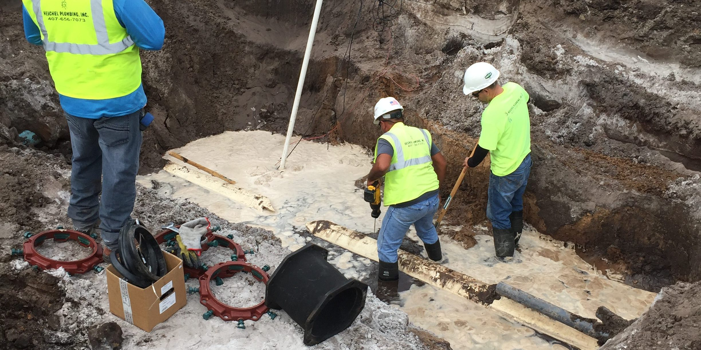 Plumbers Working Drain cleaning